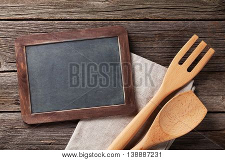 Blackboard for your text and cooking utensils. Top view with copy space