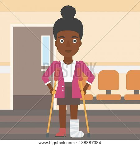 An african-american injured young woman with leg in plaster using crutches while standing in the hospital corridor. Vector flat design illustration. Square layout.