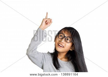 Portrait of beautiful little Asian student girl smiling and raise her pointing finger up get an idea gesture isolated on white