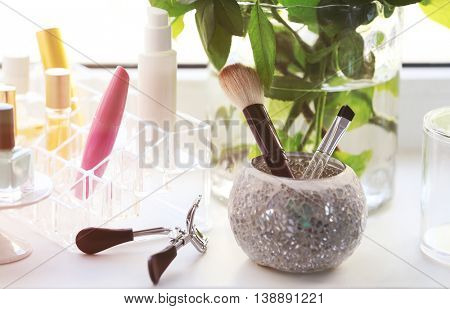 Cosmetic set on white windowsill