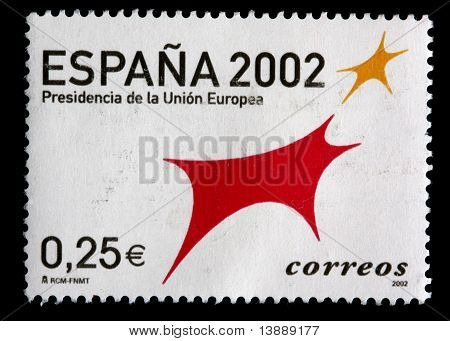 Spain - Circa 2002: A 0.25 Euro Stamp Printed In Spain Shows Red And Gold Symbols Celebrating The Pr