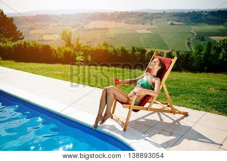 Beautiful woman sunbathing and enjoying her vacation