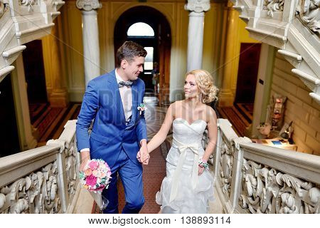 Wedding Couple Is Walking. Beautiful Model Girl In White Dress. Handsome Man In Suit. Beauty Bride W
