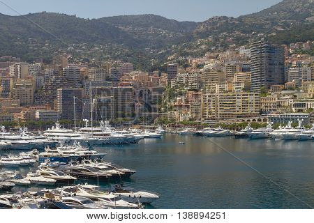 MONTE CARLO MONACO - JUNE 4 2010: View of Harbor Yachts and Residential Areas in Monte Carlo Monaco.