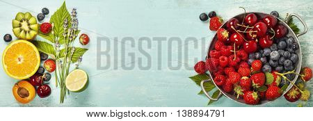 Mix of fresh berries and fruits on blue wooden background - Summer Organic Berry over Wood. Agriculture, Gardening, Harvest Concept