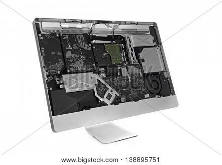 Disassembled computer monitor with internal components, isolated on white
