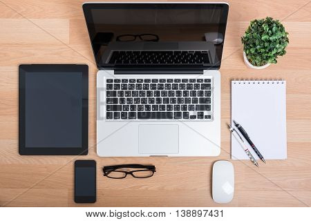Top View Open Laptop With Digital Tablet And White Smartphone