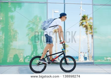 Extreme Sport. Healthy Active Lifestyle Concept. Young Bike Rider Wearing Sunglasses And Snapback Ri