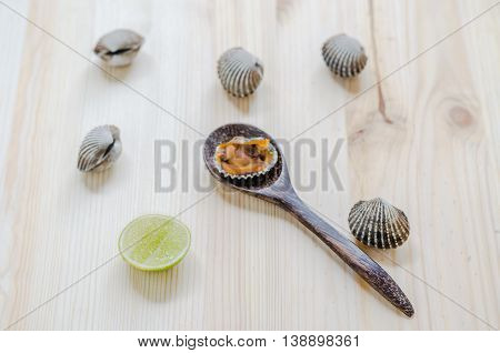 steamed blanched clams wooden background: thai food