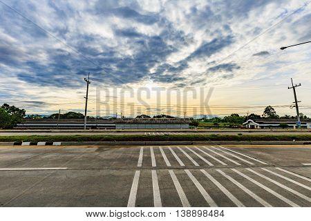 Asphalt road Highway Empty road clouds and sky sun rises