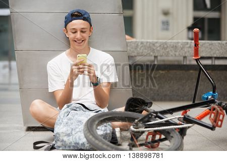 People, Technology And Communication Concept. Handsome Caucasian 15-year Old Bike Rider In Street We