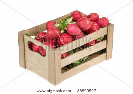 fresh radishes in a wooden crate isolated on white