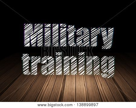 Learning concept: Glowing text Military Training in grunge dark room with Wooden Floor, black background