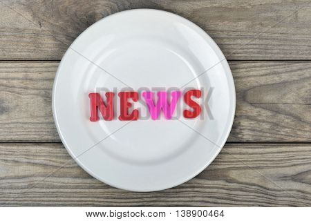 News word on white plate