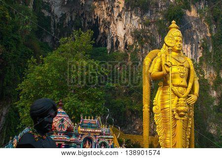 Batu Caves, Gold Statue Lord Murugan. Kuala Lumpur, Malaysia.