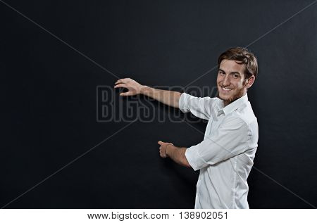 Young Adult Male in White Shirt Gesturing, Showing, Teaching