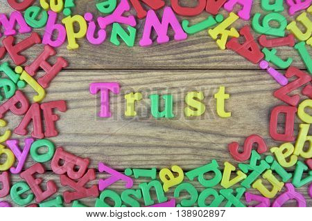 Trust word on wooden table