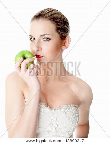 Woman enjoys an apple