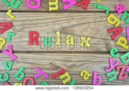 Relax word on wooden table