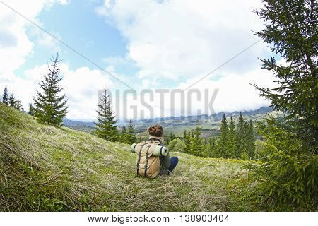 Female tourist in mountains