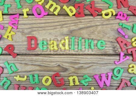 Deadline word on wooden table