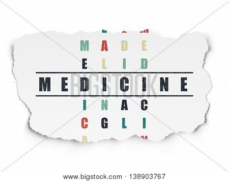 Healthcare concept: Painted black word Medicine in solving Crossword Puzzle on Torn Paper background