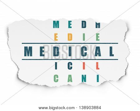 Medicine concept: Painted blue word Medical in solving Crossword Puzzle on Torn Paper background