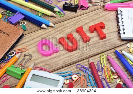 Quit word and office tools on wooden table