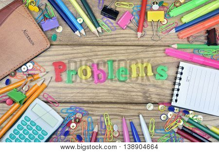 Problems word and office tools on wooden table