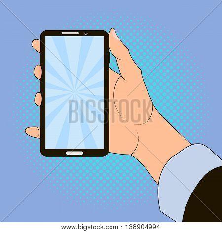 Hand holding smart phone on blue background. Pop art design