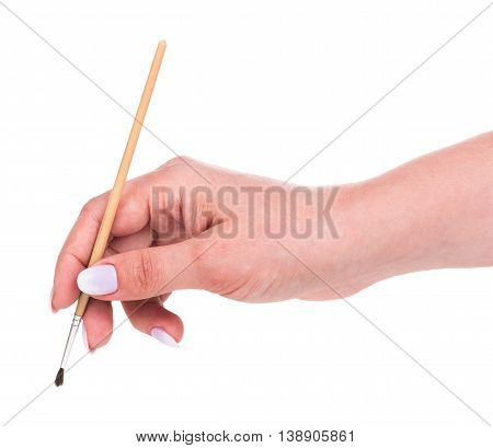 Young female hand with brush for drawing isolated over white background