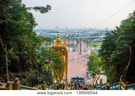 Batu Caves, Gold Statue Lord Murugan. Panorama View Of The City. Kuala Lumpur, Malaysia.