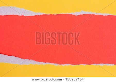 Torn yellow paper with a red background for your text.