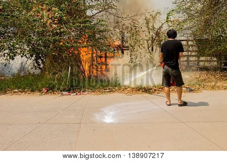 A man is trying to extinguish a fire.