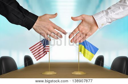 United States and Ukraine diplomats shaking hands to agree deal
