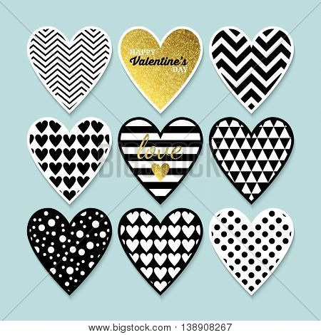 Modern heart shapes in black gold and white for Valentine's day. Isolated vector illustration