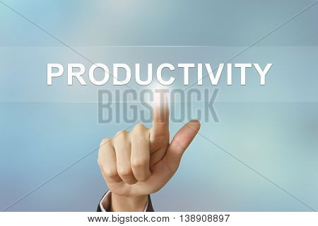 business hand pushing productivity button on blurred background
