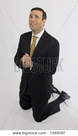 Man In Suit On Knees Begging