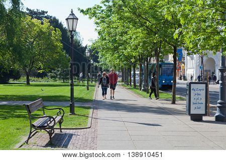 ZAGREB, CROATIA - APRIL 21th, 2016: Zagreb street with strollers and recognizable blue tram