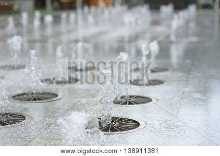 Gush of water of a fountain. Figure from the water fountain. Jet of water in city fountain.