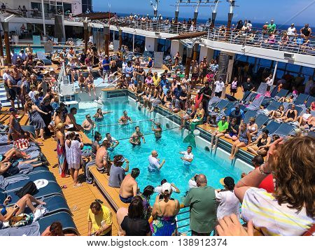NORTH ATLANTIC OCEAN - MAY 24 - The ship officers verses the passengers in a pool volleyball came onboard the Celebrity Summit on May 24 2016 in route to Bermuda.