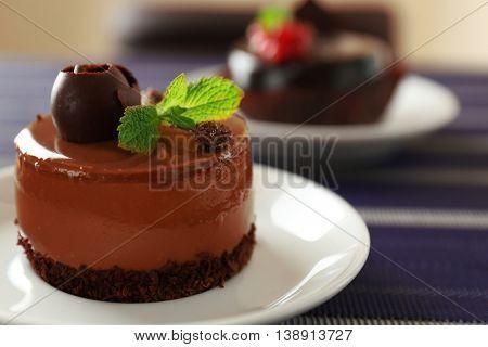 Caramel cake with tea on table