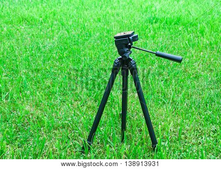A tripod for the camera on natural background