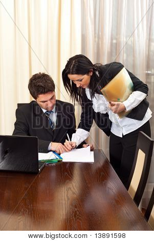 Business Woman Signing An Agreement