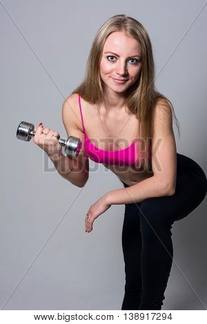 Portrait Of Smiling Beautiful Girl With Dumbbells
