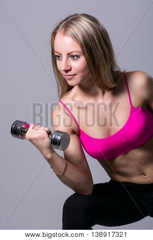 Portrait Of A Beautiful Girl With Dumbbell.