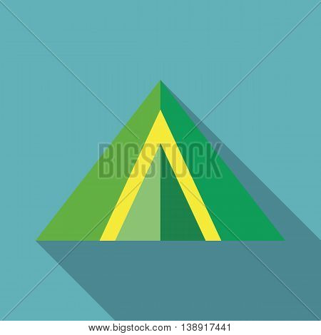 Green tent icon in flat style on a baby blue background