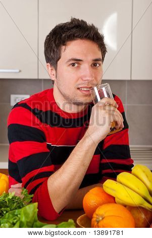 Smiling Man Drinking Fresh Orange Juice