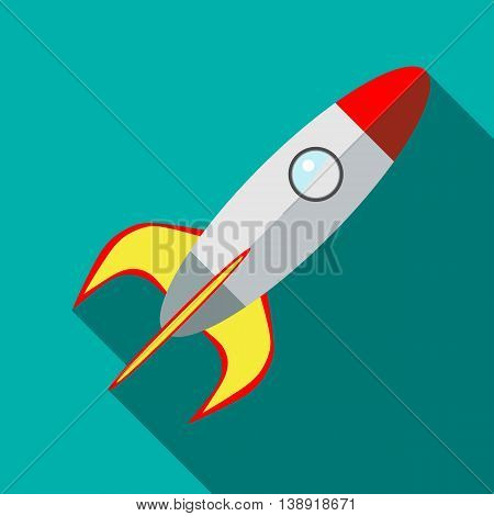 Space rocket icon in flat style on a turquoise background