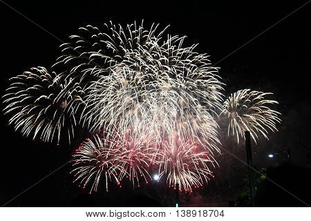 Celebration fireworks on sky. International Fireworks. Fireworks display on dark sky background.